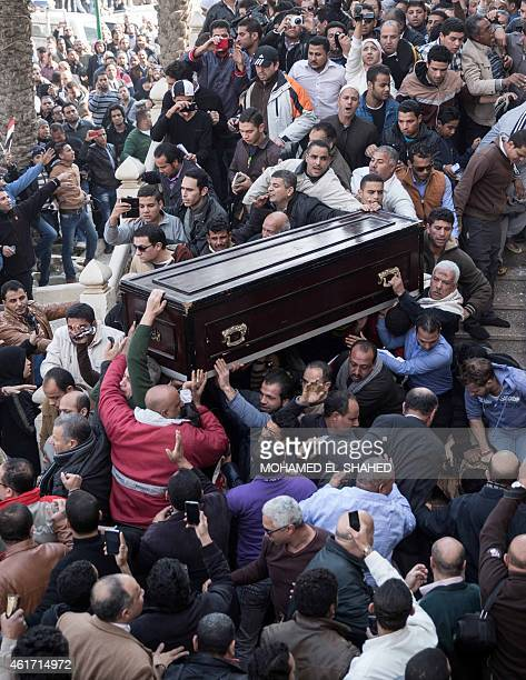 Mourners carry the coffin of Egyptian actress Faten Hamama during her funeral on January 18 2015 in 6th of October City on the outskirts of Cairo...