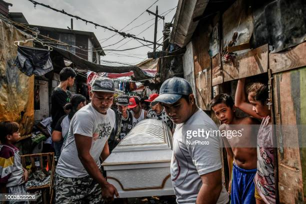 Mourners carry the coffin of Kenneth Trasmano who was killed in a police drug sting operation during his funeral at a dumpsite slum community in...