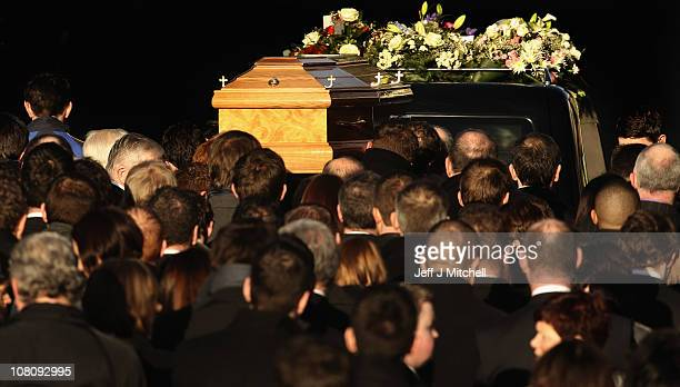Mourners carry the coffin of Michaela McAreavey on January 17 2011 in Ballygawley Northern Ireland Mrs McAreavey who is the daughter of Tyrone Gaelic...