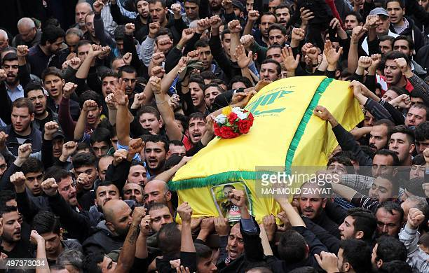 Mourners carry the coffin of Mohammad Nazar a war correspondent working for Lebanon's powerful Shiite movement Hezbollah and who was killed yesterday...