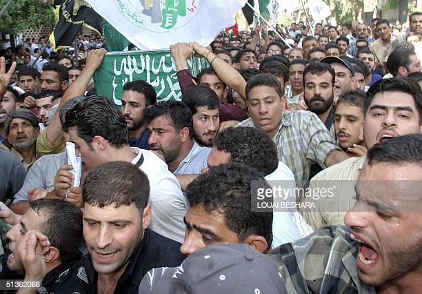 Mourners carry the coffin of one of HAMAS founder Palestinian Ezzeddine Sobhi Sheikh Khalil 27 September 2004 in Damascus Sheikh Khalil who was...
