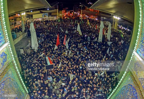 Mourners carry the coffin of slain Iraqi paramilitary chief Abu Mahdi alMuhandis towards the Imam Ali Shrine in the shrine city of Najaf in central...