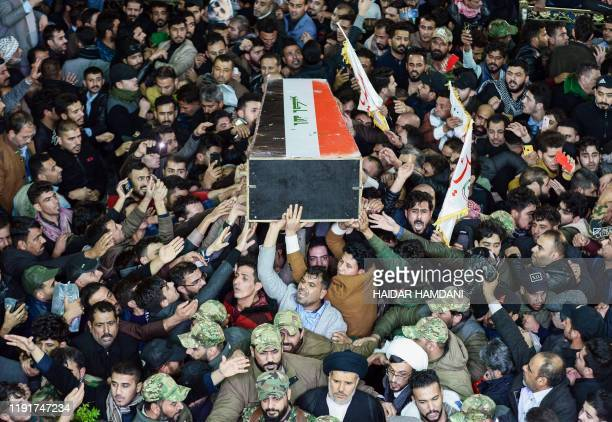 TOPSHOT Mourners carry the coffin of slain Iraqi paramilitary chief Abu Mahdi alMuhandis towards the Imam Ali Shrine in the shrine city of Najaf in...