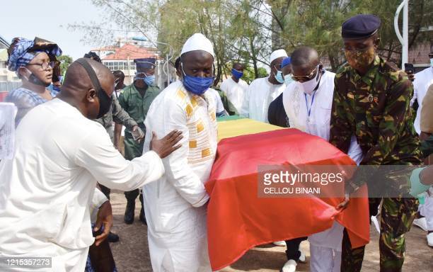 Mourners carry the coffin of the late Guinean singer Mory Kante during his funeral procession on May 26 2020 in Conakry Guinea Hundreds of people...