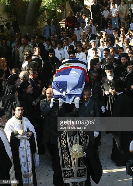 Mourners carry the coffin of the Patriarch of Alexandria Peter VII who was killed in a helicopter crash during his funeral procession at Mar Guirguis...