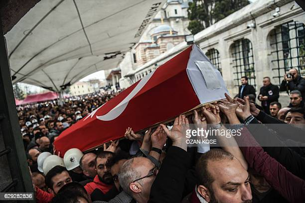 TOPSHOT Mourners carry the coffin of Turkish police officer Hasim Usta who was killed in the December 10 blasts outside Besiktas' Vodafone Arena...