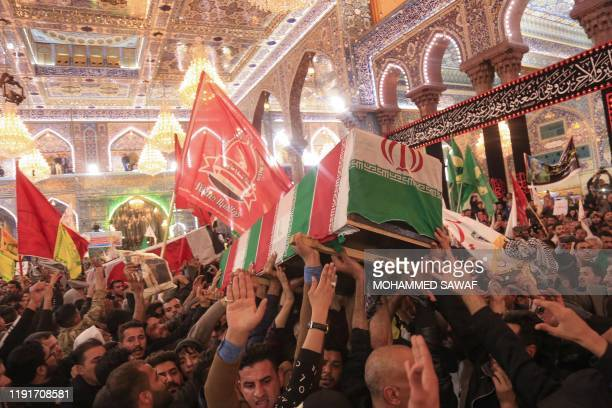 Mourners carry the coffins of slain Iraqi paramilitary chief Abu Mahdi alMuhandis Iranian military commander Qasem Soleimani and eight others inside...