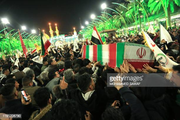 Mourners carry the coffins of slain Iraqi paramilitary chief Abu Mahdi al-Muhandis, Iranian military commander Qasem Soleimani and eight others...