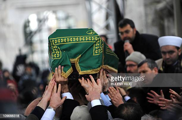 Mourners carry the the coffin of late Turkish Prime Minister Necmettin Erbakan during his funeral in Istanbul on March 1 2011 Tens of thousands of...