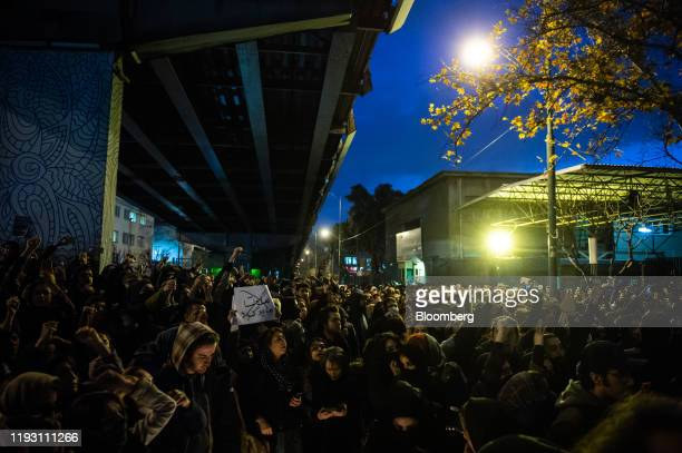 Mourners chant while gathering during a vigil for the victims of the Ukraine International Airlines flight that was unintentionally shot down by...