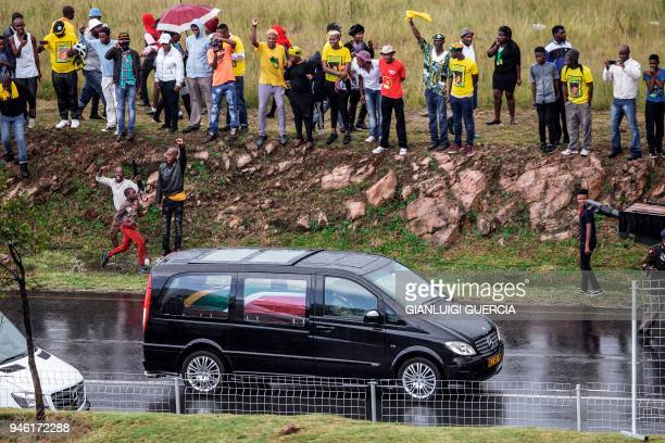Mourners cheer as the coffin containing the body of the antiapartheid icon Winnie MadikizelaMandela is escorted at the burial site at the end of her...