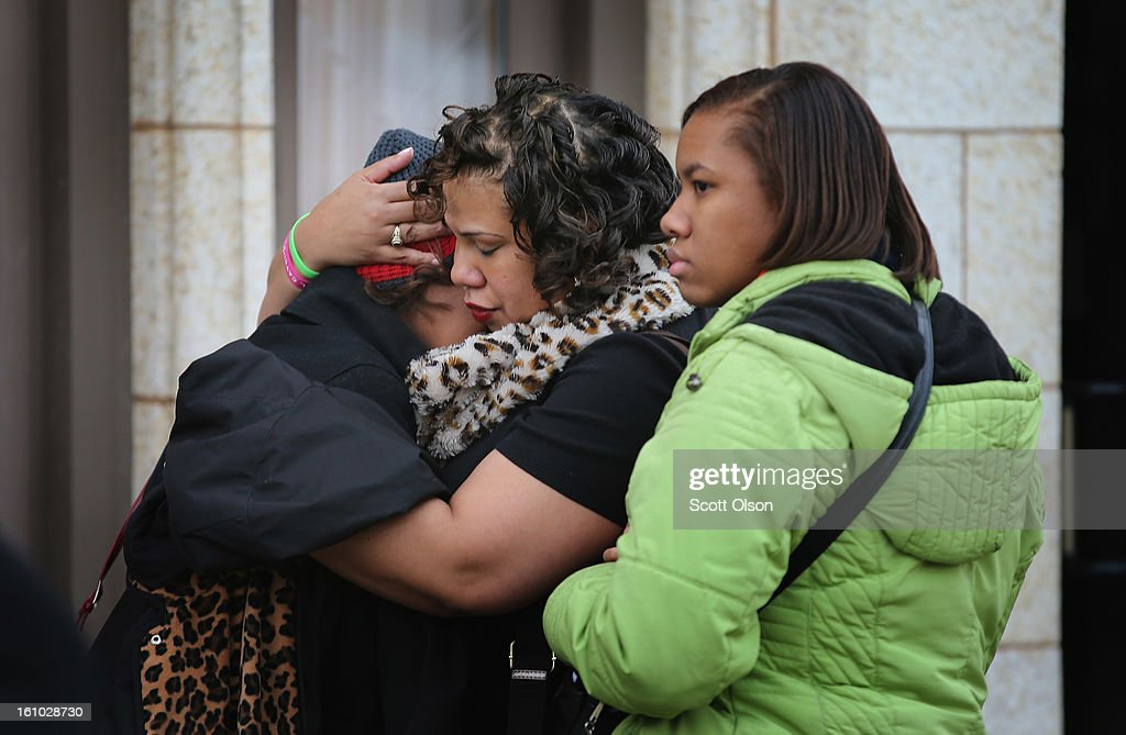 Mourners comfort each other after attending the wake of 15-year-old Hadiya Pendleton at the Calahan Funeral Home on February 8, 2013, in Chicago, Illinois. Hadiya was killed when a gunman opened fire on her and some friends as they stood under a shelter on a warm rainy afternoon in a park about a mile from President Obama's Chicago home. First lady Michelle Obama is expected to attend tomorrow's funeral with senior White House adviser Valerie Jarrett and Education Secretary Arne Duncan.
