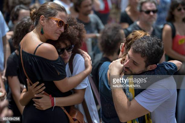 Mourners comfort each other during the funeral of slain Brazilian councilwoman and activist Marielle Franco outside Rio de Janeiro's Municipal...