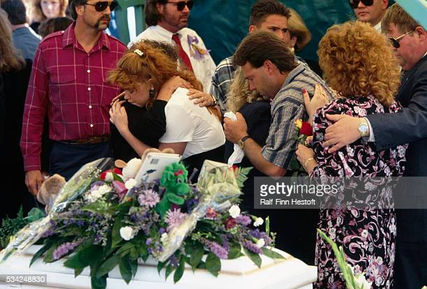 Mourners comfort Edye and Tony Smith parents of Chase and Colton Smith at the boys' funeral Chase and Colton were killed in the Oklahoma City bombing...