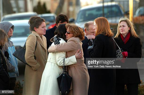 Mourners comfort one another during a wake in Boston Mass for Imette St Guillen on what would have been her 25th birthday St Guillen a graduate...