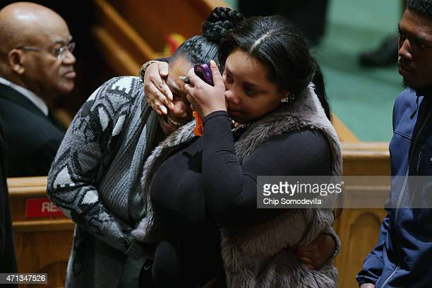 Mourners comfort one another during the funeral for Freddie Gray at the New Shiloh Baptist Church during his funeral April 27 2015 in Baltimore...