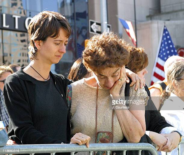Mourners consol one another as names of lost one's are read aloud September 11 during the ceremony commemorating the September 11 2001 attacks on the...