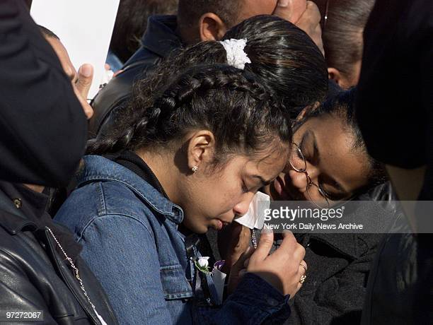 Mourners console one another during a prayer service for victims of the crash of American Airlines Flight 587 at Jacob Riis Park in the Rockaways...