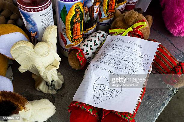 Mourners covered a park table at the Cudell Commons Park with stuffed animals prayer candles and letters for 12year old Tamir Rice in Cleveland Ohio...