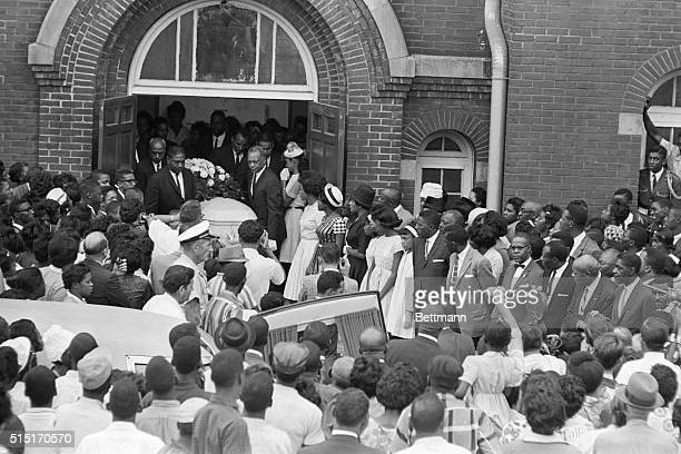 Mourners crowd the entrance to St John's African Methodist Church as the casket containing the body of 14yearold Carol Robertson from the church...