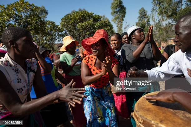 Mourners dance and sing as the funeral takes place for Ishmael Kumire on August 4 2018 in Chinamhora Zimbabwe Ishmael was killed during deadly...