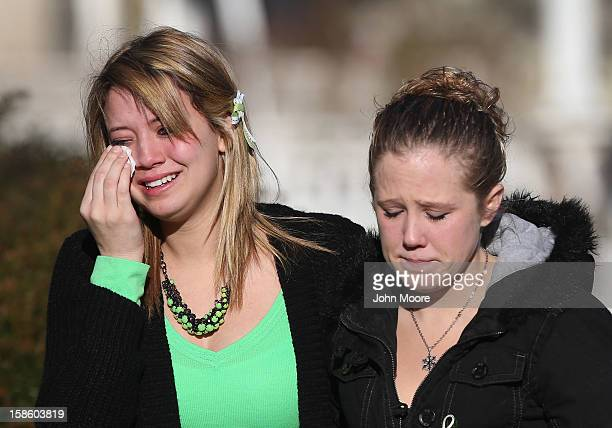 Mourners depart a wake for Jesse Lewis on December 20 2012 in Newtown Connecticut Jesse was killed when 20 children and six adults were massacred at...