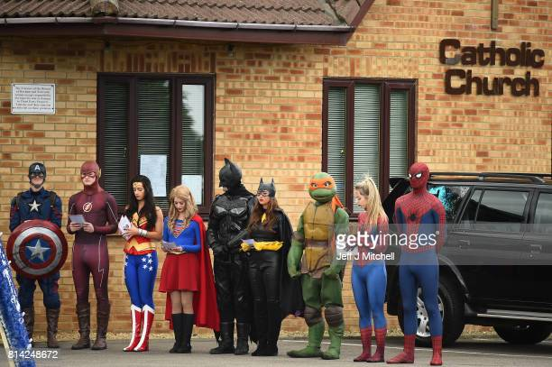 Mourners dressed as Super Heroes attend the funeral of six year old Sunderland FC fan Bradley Lowery at St Joseph's Church on July 14 2017 in...