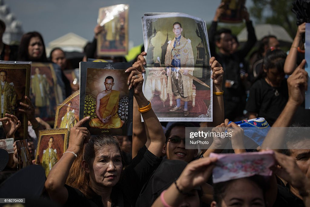 Mourners dressed in black gathers around the Grand Palace while carrying several portraits of the king as they wait to perform the Royal Anthem at Sanam Luang in Bangkok, Thailand on October 22, 2016. More than 100.000 mourners from across Thailand came during the long week end holiday to sing the Thai Royal Anthem to pay respect to the late Thailand King Bhumibol Adulyadej who passed away on October 13, 2016 at Siriraj Hospital. Thai King Bhumibol Adulyadej was the world's longest reigning monarch and died at the age of 88 after a long illness since several years, he was the most unifying symbol for Thai people and leaving behind him a divided country under military control.