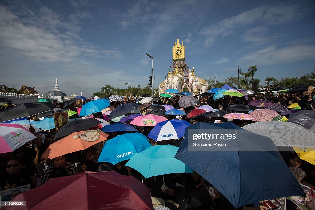 Mourners dressed in black while carrying umbrellas gather around the Grand Palace as they wait to perform the Royal Anthem at Sanam Luang. More than 100.000 mourners from across Thailand came during the long week end holiday to sing the Thai Royal Anthem to pay respect to the late Thailand King Bhumibol Adulyadej who passed away on October 13, 2016 at Siriraj Hospital. Thai King Bhumibol Adulyadej was the world's longest reigning monarch and died at the age of 88 after a long illness since several years, he was the most unifying symbol for Thai people and leaving behind him a divided country under military control.