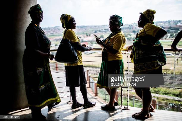 Mourners dressed in the colours of the ruling African National Congress , attend the funeral of anti-Apartheid champion Winnie Madikizela- Mandela at...