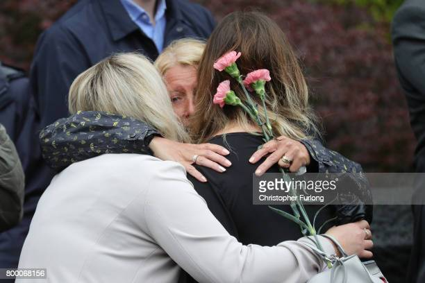 Mourners embrace as the funeral cortege of Manchester attack victim Alison Howe leaves St Anne's Church on June 23 2017 in Oldham England Alison Howe...