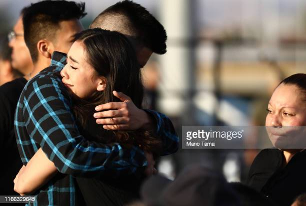 Mourners embrace at a vigil honoring Horizon High School sophomore Javier Amir Rodriguez who lost his life in a mass shooting in nearby El Paso on...