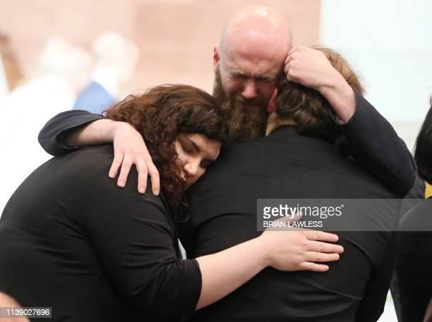 Mourners embrace at the funeral service of journalist Lyra McKee who was killed by a dissident republican paramilitary in Northern Ireland on April...