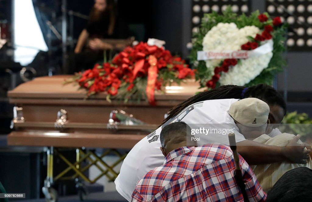 Mourners embrace before the funeral services for police shooting victim, Stephon Clark at Bayside Of South Sacramento Church, March 29, 2018 in Sacramento, California. Clark, who was unarmed, was shot and killed by Sacramento Police Officers, Sunday, March 18, 2018.