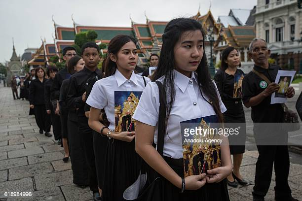 Mourners enter Grand Palace to pay respect for the first time before the Royal Hall urn containing the body of Thailand's King Bhumibol Adulyadej...