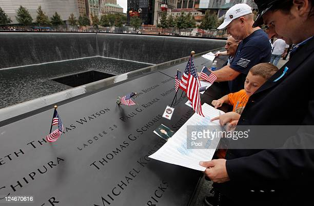 Mourners etch the names of a lost loved ones during tenth anniversary ceremonies of the September 11 2001 terrorist attacks at the World Trade Center...