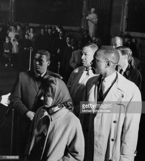 Mourners file past the coffin of US President John F Kennedy in the Rotunda of the Capitol Building in Washington DC 24th November 1963