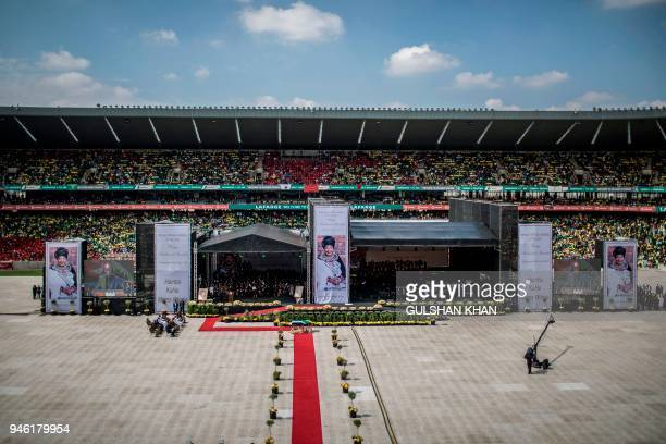 Mourners fill the 37,500-seater Orlando Stadium in the township of Soweto to pay their last respects to the late anti-apartheid champion Winnie...