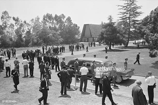Mourners follow the hearse with movie star Marilyn Monroe's casket being taken from the chapel to its final resting place at Westwood Memorial Park...