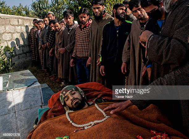 Mourners for the funeral prayers of Irshad Ahmad a local pro Kashmir rebel killed in a gun battle with the Indian government forces during his...