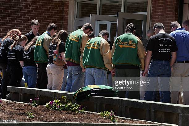 Mourners form a prayer circle at Narrows High School before the funeral of Jarrett Lane April 21 2007 in Narrows Virginia Lane a 22yearold senior at...