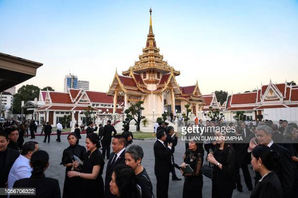Mourners from Thailand's elite arrives at the Wat Thepsirin Buddhist temple in Bangkok for the funeral ceremony of Leicester City's Thai owner and...