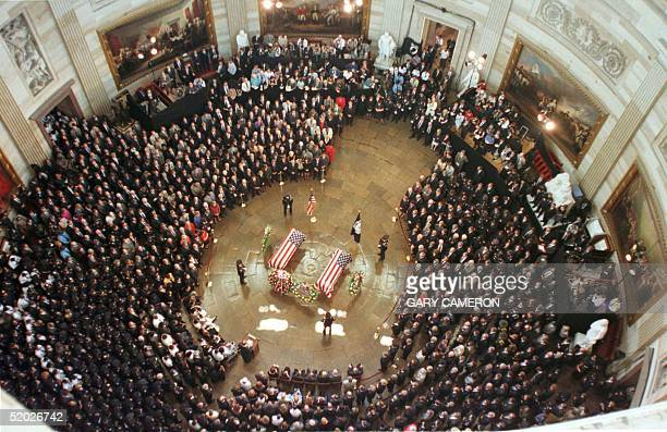 Mourners gather 28 July in the Capitol Rotunda where the bodies of two police officers killed when a gunman opened fire in the Capitol lie in state...