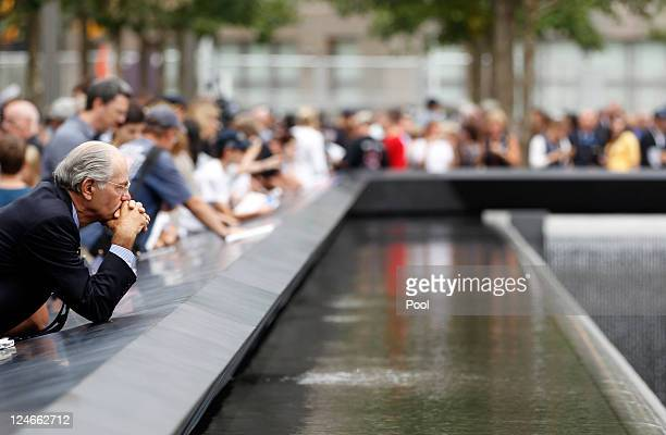 Mourners gather around a memorial pool during tenth anniversary ceremonies of the September 11 2001 terrorist attacks at the World Trade Center site...