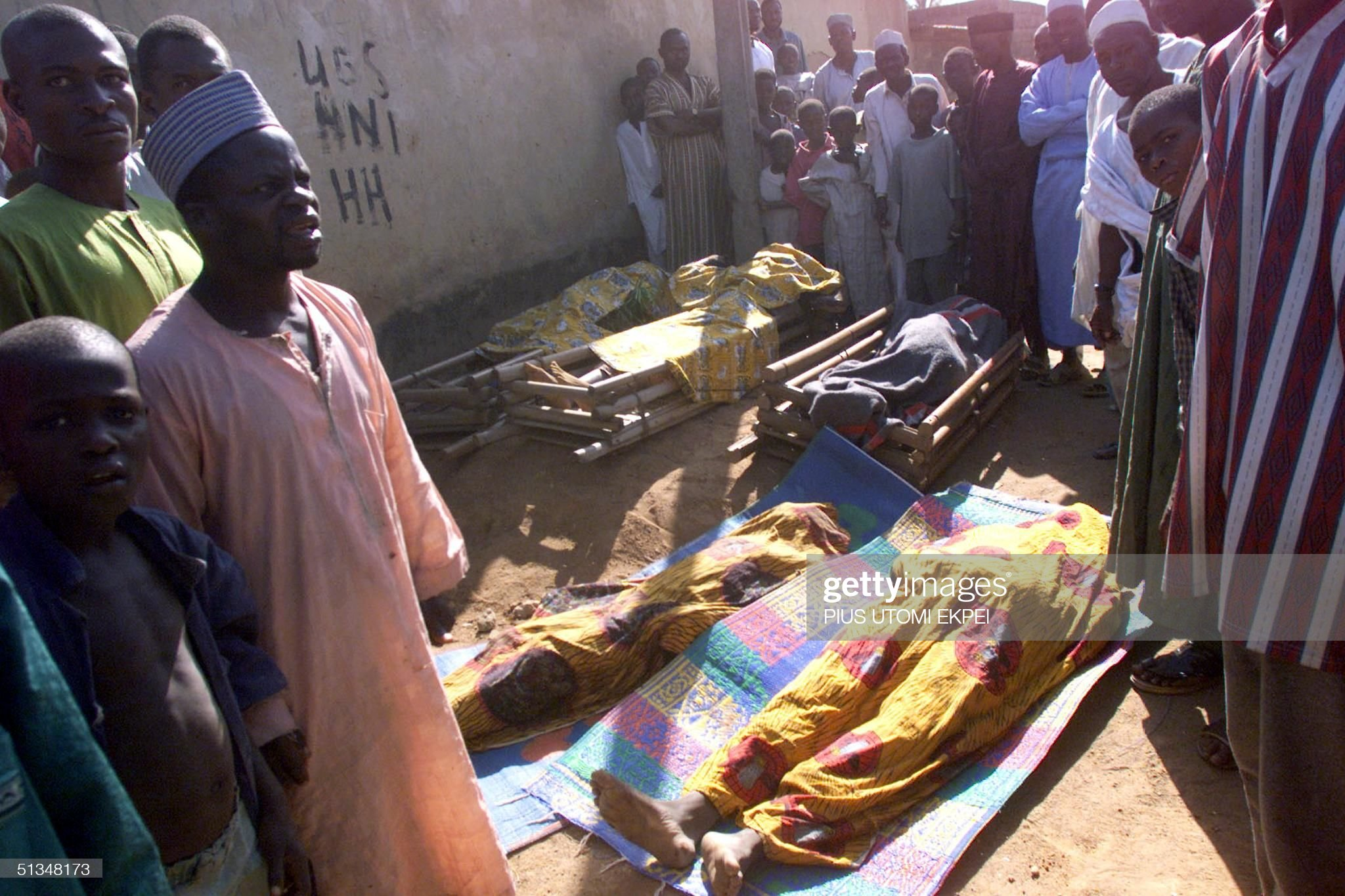 Mourners gather around five dead bodies lying on t : News Photo