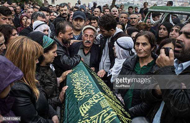 Mourners gather around the coffin of Sarigul Tuylu a mother of two that was killed in Saturday's bombing attacks in Ankara Turkey during her funeral...