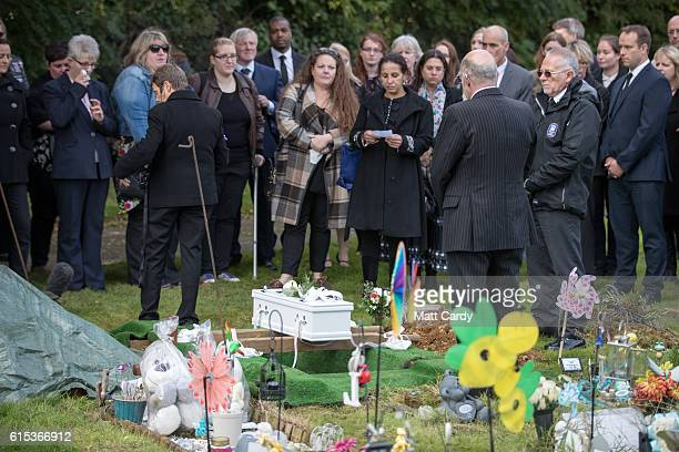 Mourners gather around the graveside for the funeral of a baby girl who was found dead on a footpath earlier this year at Wolvercote Cemetery on...