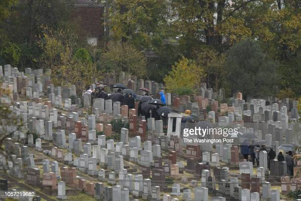 Mourners gather around the gravesite of Irving Younger one of the victims of the Tree of Life Synagogue shooting at Shaare Torah Cemetery on...