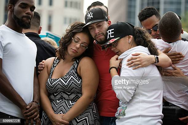 Mourners gather at a makeshift memorial prior to an evening vigil for the victims of the Pulse Nightclub shootings at the Dr Phillips Center for the...