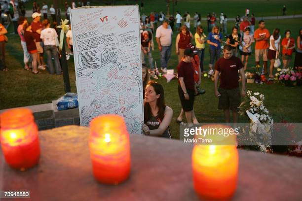 Mourners gather at a makeshift memorial to the 32 shooting victims on the Virginia Tech campus April 22 2007 in Blacksburg Virginia Students will...